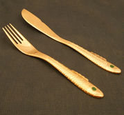 Nobel fiskbestick kniv o gaffel  i guld